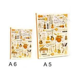 cahier de notes motif instruments
